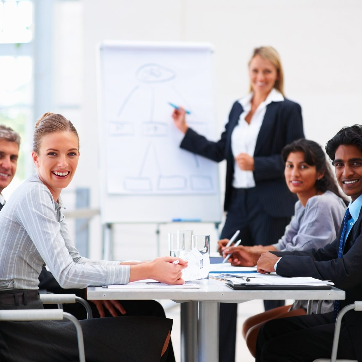 Portrait of confident happy business people sitting in a conference for training